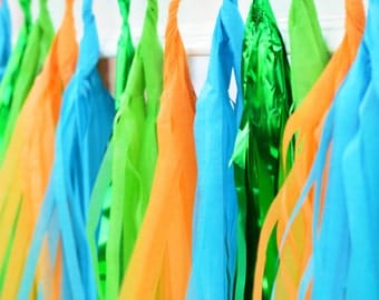 Tassel Garland Banner. Tassel banner with green, orange, blue and mylar green. Dinosaur party decorations, Dinosaur garland, Monster party