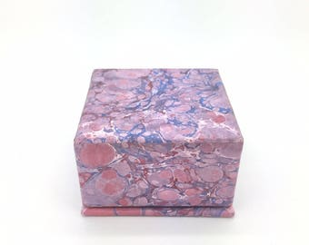 Tiny treasure box. Plumcoloured, hand marbled paper box with soft blue lining