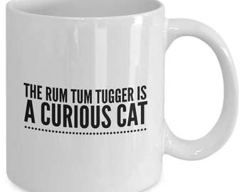 The RUM TUM TUGGER is a Curious Cat - Cats The Musical Inspired Mug - Broadway Fan Gift - 11 oz white coffee tea cup
