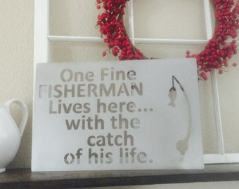 One Fine Fisherman Lives here with the catch of his life