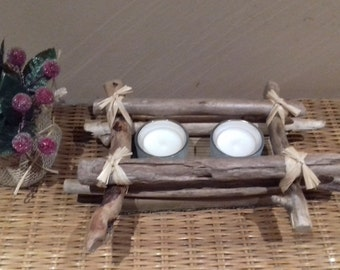 Candlestick in Driftwood with two candles.