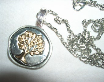 A pendant featuring the tree of life