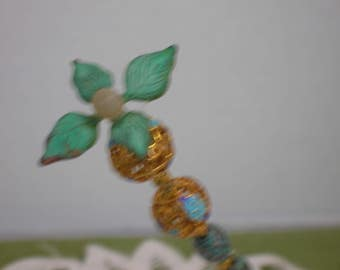 A Vintage hatpin with turquoise leaves