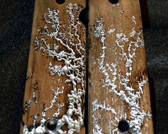 Walnut 1911 grips with lichtenberg figure and silver leaf. Resin coated
