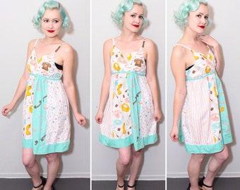 60's Style Telephone Novelty Print Babydoll Dress | Empire Waist | Criss-Cross Bust | Size Medium