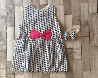 Homemade girls navy and white polka dot dress with pink bow
