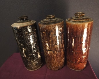 Three Vases  in mottled brown no identiying marks   size height =20cm