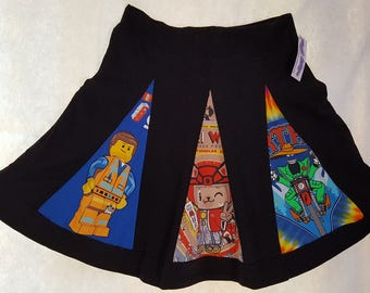 T-Skirt: This skirt wants to go out and have fun! It has a black background with colorful, lively panels. Comfortable, soft and unique!
