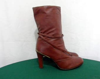 Sz 8.5 Vintage short Maroon leather 1980s women high heel boots with wrap around strap.