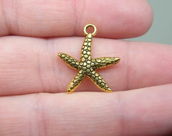 8 Gold Tone Starfish Charms or  Pendants. B-004