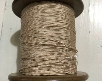 Vintage, Hard to Find Lestershire Everlastiing spool full of off white elastic thread