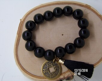 N1254 Large Black Ceramic  Beaded Bracelet with a Chinese Coin and Tassel.
