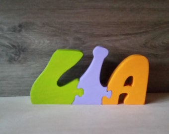 Puzzle wooden name letters. Lia