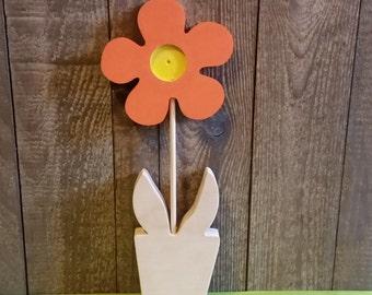 Orange wooden flower