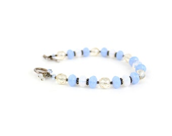 Blue lampwork bracelet with art glass beads and sterling silver toggle clasp