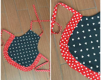 3 or 4 year old mini child apron. Girl apron. Mickey Mouse white print on black. Red with white polka dots on frills and ties