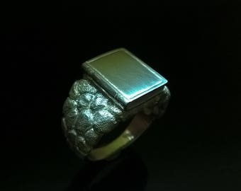 Men's silver ring in the form of books.