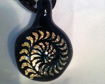 Dichroic pinwheel pendant with black background