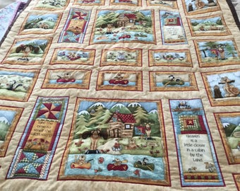 Very nice baby or toddler boy quilt.  42x46. Wilderness theme.
