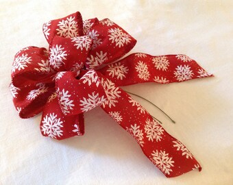 3 red bows with snowflake pattern