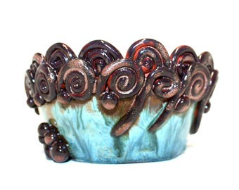 Beautiful multicoloured hand thrown bowl with coiled decoration.