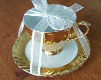Classic Australia Fine China Gold and White Cup and Saucer