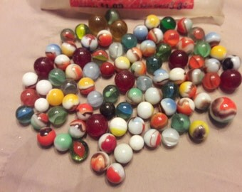 89 assorted marbles and original vitro-agate bag from the 1960's
