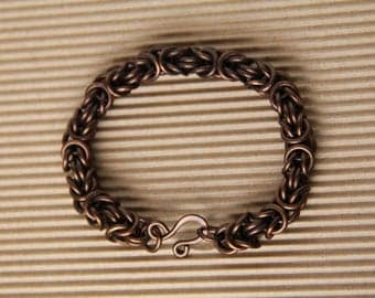 The copper bracelet of the Byzantine weave, the patinated