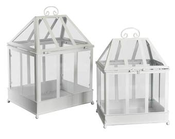 Large and small lanterns set in white metal Greenhouse