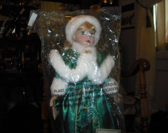 This Avon doll is Lorraine Holoiday Radiance doll is a new 18 inch tall doll.