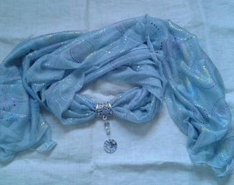 grey scarf and its gem dial
