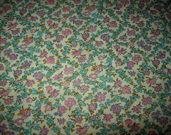 A lovely vintage fabric flowers in pastel colours