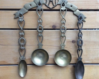 French antique brass kitchen utensils with decorative rack. French brass serving spoons.