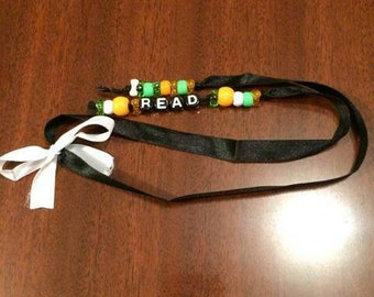 Black and white pony beads ribbon bookmark w/a white bow(read)