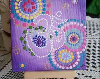 Purple Om 10cm x 10cm dotpainting Acrylic on canvas board. Comes with display stand.
