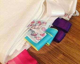 Unicorn ribbon tagged muslin sheet