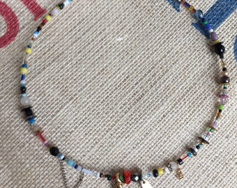Playful necklace made from recycled beads and chains.