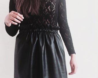 Black matte leather skirt.