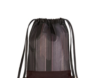 Leather drawstring backpack with 3D textile design