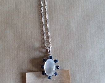 sweet little pendant, silver with a Moonstone and blue rhinestones