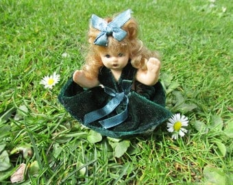 Another adorable Portuguese porcelain doll in sitting position, 8cm tall