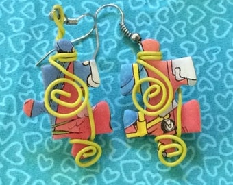 Jigsaw puzzle and telephone wire earrings.