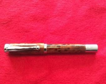 Custom pen made of Thuya Burl