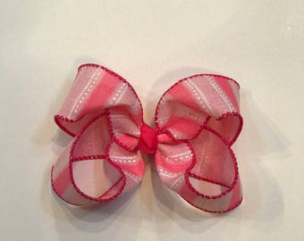 Pink and white striped hair bow