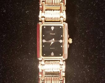 watch gold toned black