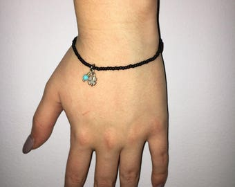 black beaded bracelet with clover charm
