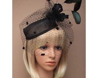 black pillbox fascinator hat.