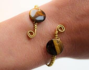 brass bracelet with tiger's eye