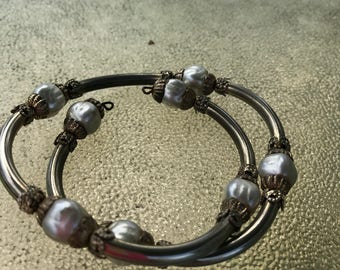 Gold toned bracelet with white beads