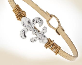 Wire wrapped Fleur de Lis on goldtone bangle